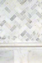 Arabescato Carrara Herringbone Pattern and 4x4 Honed and Beveled Tile